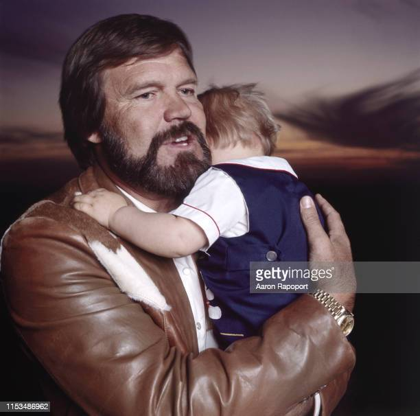 Singer Glenn Campbell and his son pose for a portrait circa 1993 in Tucson Arizona