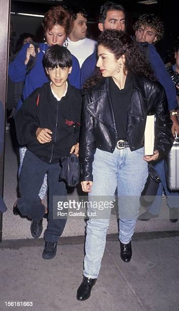 Singer Gloria Estefan and son Nayib Estefan being photographed on November 25 1991 at Los Angeles International Airport in Los Angeles California