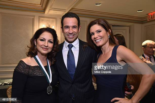 Singer Gloria Estefan Auto Racing Driver Helio Castroneves and his wife Adriana Henao attend the 30th Annual Great Sports Legends Dinner to benefit...