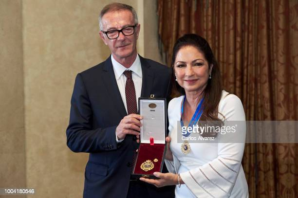 Minister of Culture Joe Guirao delivers the Golden Medal In Fine Arts to Gloria Estefan at Royal Theatre on July 23 2018 in Madrid Spain