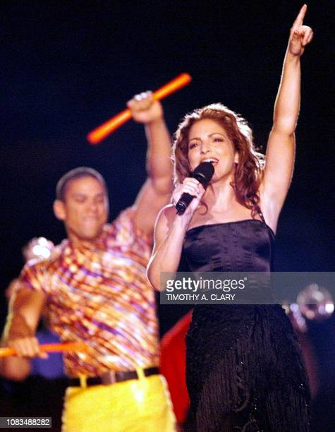US singer Gloria Estefan sings during the halftime show at Super Bowl XXXIII 31 January at Pro Player Stadium in Miami FL AFP PHOTO/TIM CLARY