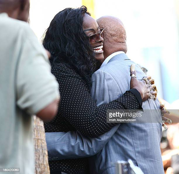 Singer Goldean White and music producer/songwriter Berry Gordy attend the late Barry White's posthumous honoring of a star on the Hollywood Walk of...