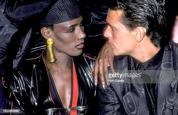 Singer Grace Jones and actor Robert Rusler attend the Vamp New York City Premiere Party on July 15 1986 at Stringfellow's in New York City