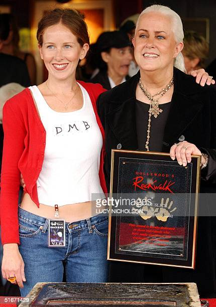 US singer Grace Slick poses with her daughter China Kantner after signing the cement in Hollywood's Rockwalk in Los Angeles 22 October 2002 Slick was...