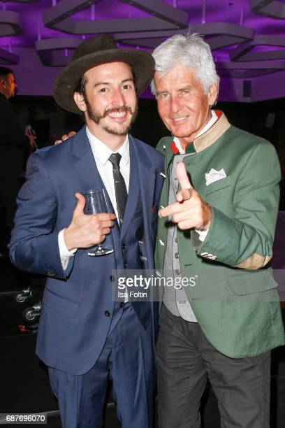 Singer Graham Candy and german presenter Frederic Meisner during the Kempinski Fashion Dinner on May 23 2017 in Munich Germany