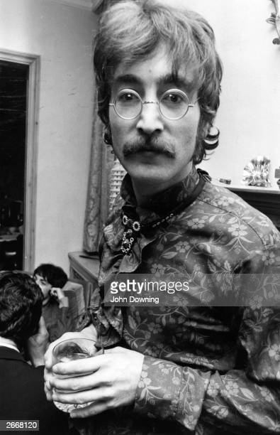 Singer guitarist and songwriter John Lennon at manager Brian Epstein's west London home for a photocall for the launch of the Beatles' new album...