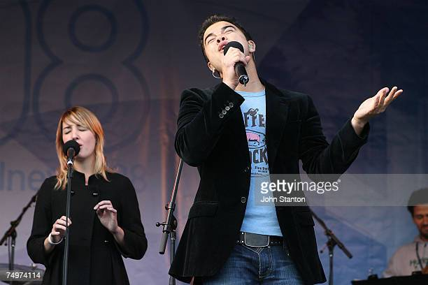 Singer Guy Sebastian and girlfriend Julie Egan perform at the event marking the Sydney arrival of The World Youth Day Cross and Icon at Tumbalong...