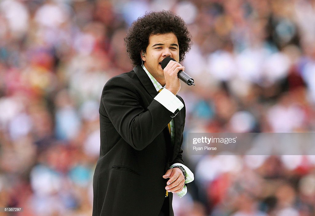 Singer Guy Sebastian performs before the AFL Grand Final between the Port Adelaide Power and the Brisbane Lions at the Melbourne Cricket Ground September 25, 2004 in Melbourne, Australia.