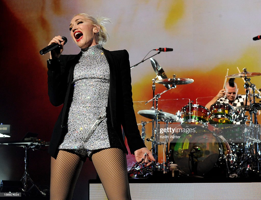 Singer Gwen Stefani (L) and musician Adrian Young of No Doubt perform at Gibson Amphitheatre on November 24, 2012 in Universal City, California.