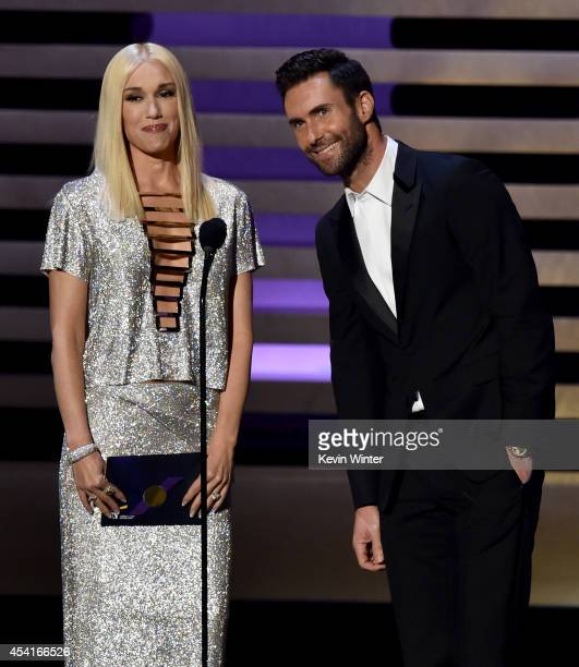 Singer Gwen Stefani and singer/TV personality Adam Levine speak onstage at the 66th Annual Primetime Emmy Awards held at Nokia Theatre L.A. Live on...
