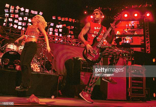Singer Gwen Stefani, left, and basist Tony Kanal perform live with their band No Doubt December 17, 2000 at K-ROQ''s Almost Acoustic Christmas...