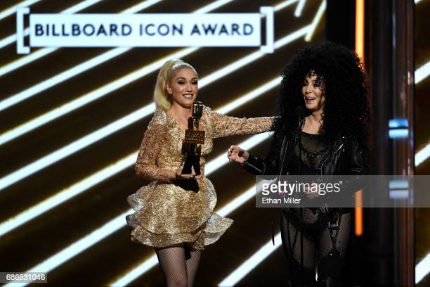 Singer Gwen Stefani presents the Billboard Icon Award to actress/singer Cher onstage during the 2017 Billboard Music Awards at TMobile Arena on May...