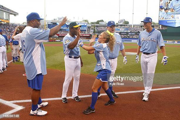 Singer Haley Reinhart highfives Legends Rickey Henderson and Bo Jackson durning the opening ceremonies before the 2012 Taco Bell AllStar Legends...
