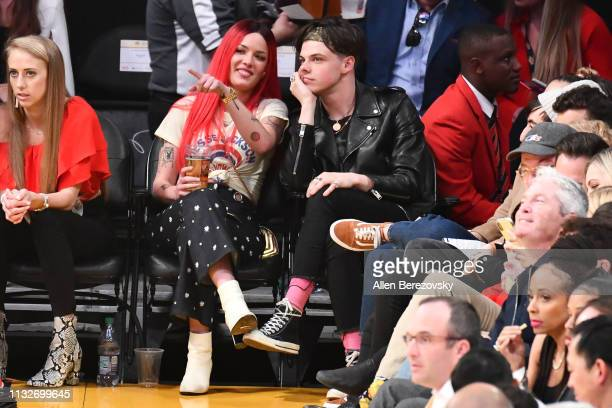 Singer Halsey and musician Yungblud attend a basketball game between the Los Angeles Lakers and the New Orleans Pelicans at Staples Center on...