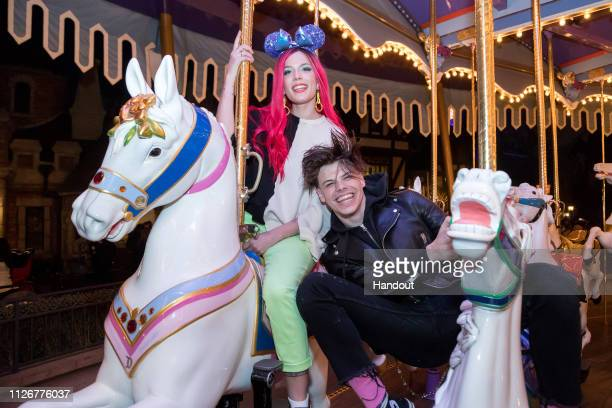 Singer Halsey and musician Yungblud ride on King Arthur Carrousel at Disneyland Park on February 22 2019 in Anaheim California