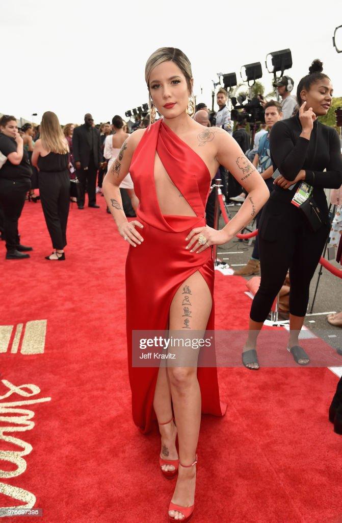 Singer Halsey attends the 2018 MTV Movie And TV Awards at Barker Hangar on June 16, 2018 in Santa Monica, California.