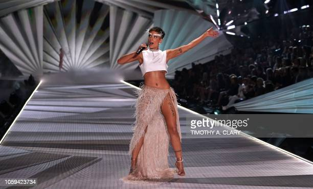 Singer Halsey performs on the runway at the 2018 Victoria's Secret Fashion Show on November 8 2018 at Pier 94 in New York City Every year the...