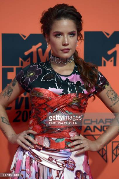 Singer Halsey poses on the red carpet upon her arrival to the MTV Europe Music Awards at the FIBES Conference and Exhibition Centre of Seville on...