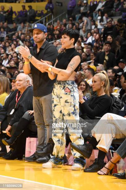 Singer Halsey reacts to a play the game between the Los Angeles Lakers and the Cleveland Cavaliers on January 13 2020 at STAPLES Center in Los...