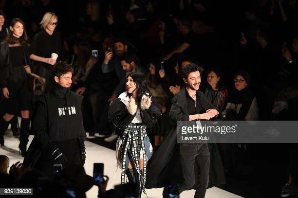 Singer Hande Yener and fashion designer Kadir Kilic and models on the runway at the Miin by Kadir Kilic show during Mercedes Benz Fashion Week...