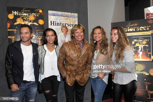 Singer Hansi Hinterseer, his wife Ramona , his daughters Laura and Jessica with her boyfriend Timo Scheider smile at the Filmtheater in Kitzbuehel,...