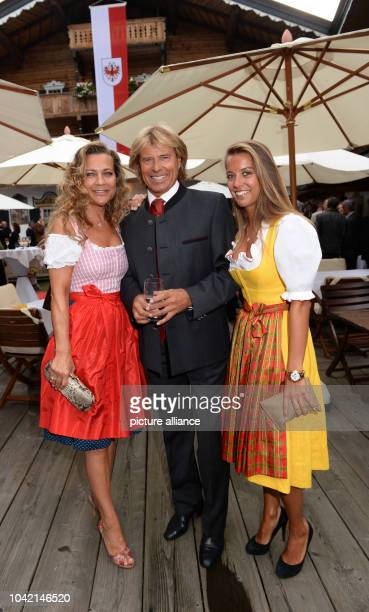 Singer Hansi Hinterseer, his wife Ramona(L9 and his daughter Laura pose prior to the GoldenRouletteBall award ceremony at Hotel Stanglwirt in...