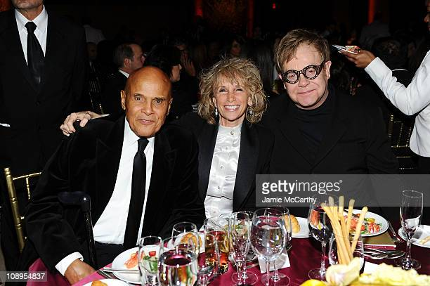Singer Harry Belafonte Julie Robinson and singer Elton John attend the amfAR New York Gala to kick off Fall 2011 Fashion Week at Cipriani Wall Street...