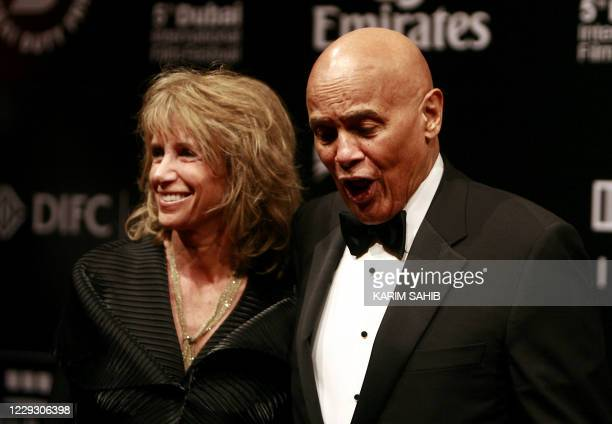 US singer Harry Belafonte with his wife Pamela stand on the red carpet on the opening night of the Dubai International Film Festival's fifth edition...