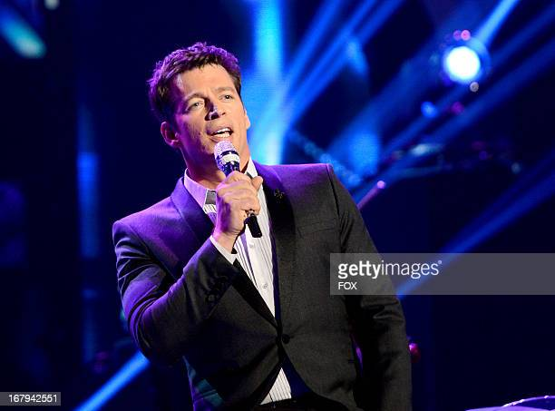 Singer Harry Connick Jr performs onstage at FOX's American Idol Season 12 Top 4 to 3 Live Elimination Show on May 2 2013 in Hollywood California