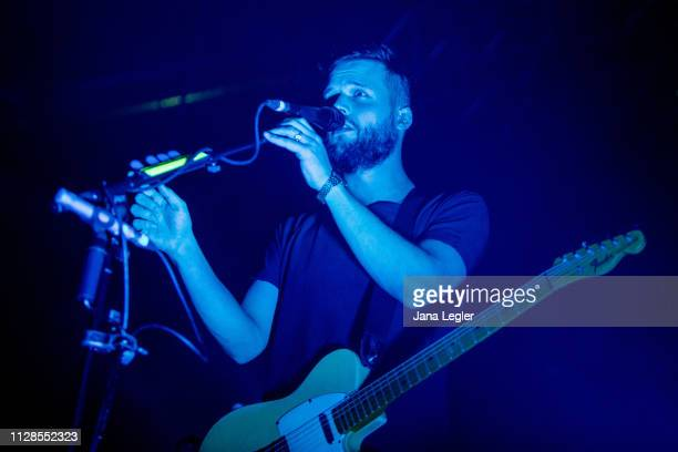 Singer Harry McVeigh of White Lies performs live on stage during a concert at the Huxleys Neue Welt on March 03 2019 in Berlin Germany