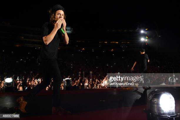 Singer Harry Stiles of One Direction performs onstage during the One Direction Where We Are Tour at Rose Bowl on September 11 2014 in Pasadena...