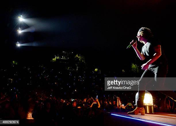 Singer Harry Styles of One Direction performs onstage during the One Direction Where We Are Tour at Rose Bowl on September 11 2014 in Pasadena...