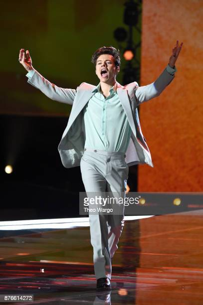 Singer Harry Styles performs on the runway during the 2017 Victoria's Secret Fashion Show In Shanghai at MercedesBenz Arena on November 20 2017 in...