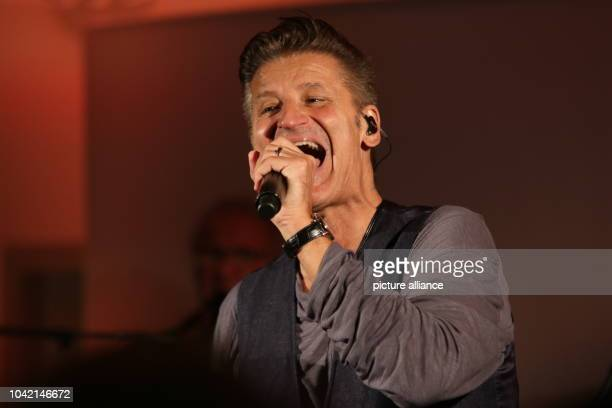 Singer Hartmut Engler of the German pop band Pur performs on stage on Brocken mountain Germany 21 March 2016 Radio station 'Radio SAW' organised a...