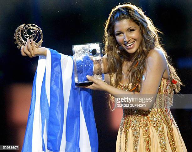Singer Helena Paparaizou of Greece winner of the 50th Eurovision Song Contest for her song My Number One holds her awards on stage in Kiev 22 May...