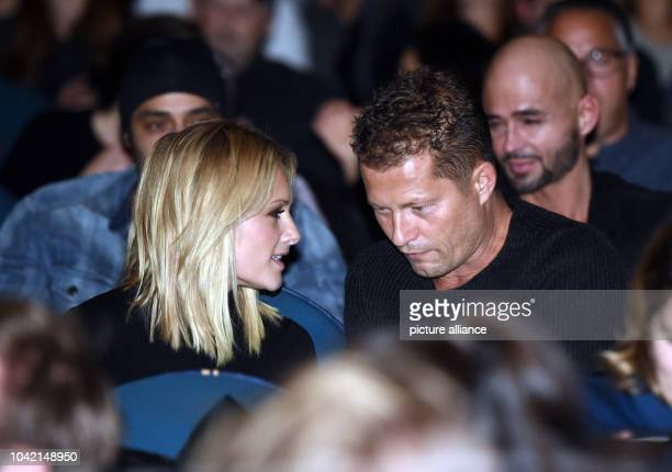 Singer Helene Fischer and actor Til Schwieger sit during the premiere of the film 'Der grosse Schmerz' from the TV seried 'Tatort' in the Kino...