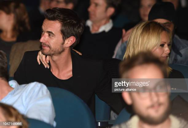 Singer Helene Fischer and host Florian Silbereisen sit during the premiere of the film 'Der grosse Schmerz' from the TV seried 'Tatort' in the Kino...