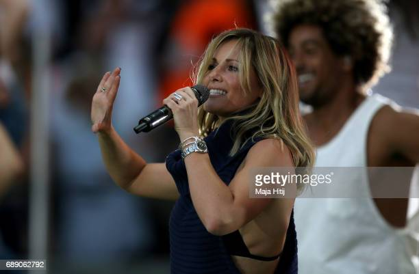 Singer Helene Fischer performs during the DFB Cup final match between Eintracht Frankfurt and Borussia Dortmund at Olympiastadion on May 27 2017 in...