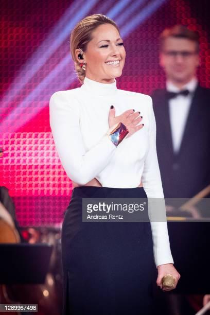 """Singer Helene Fischer performs on stage during the TV show """"2020! Menschen, Bilder, Emotionen! - Der grosse RTL Jahresrueckblick"""" on December 06,..."""