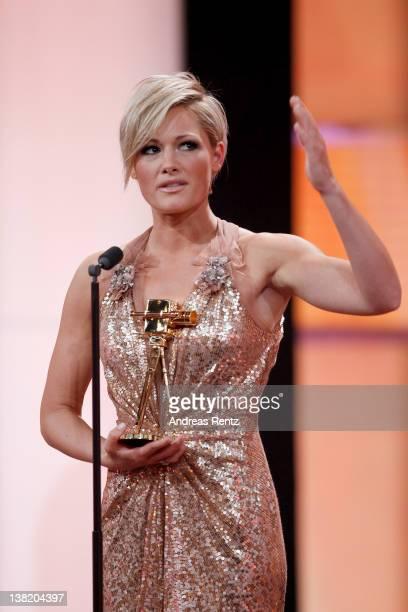 Singer Helene Fischer receives the Goldene Kamera Best Music National during the 47th Golden Camera Awards at the Axel Springer Haus on February 4...