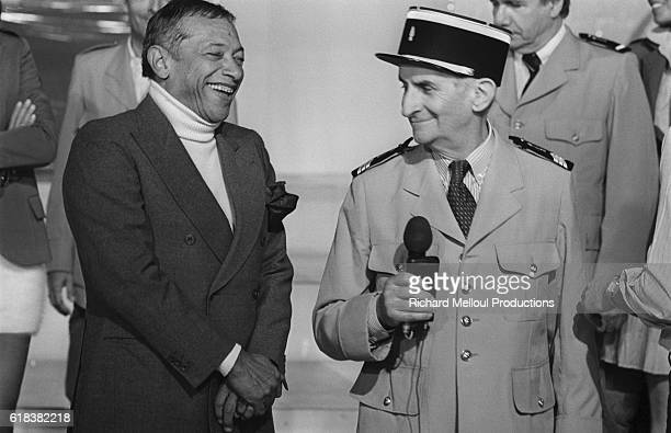 Singer Henri Salvador and actor Louis de Funes share a laugh together They are appearing on the French television show ChampsElysees