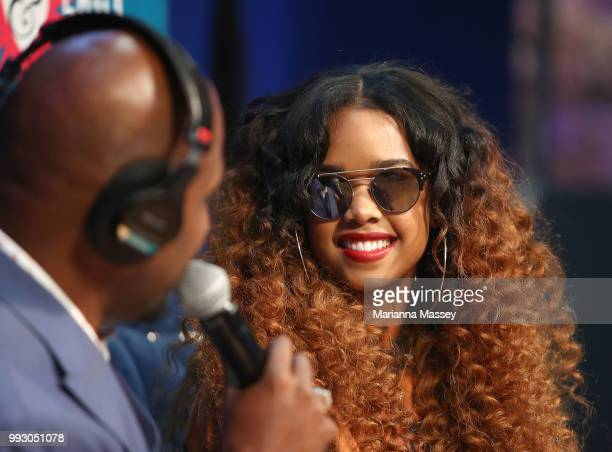 Singer HER is interviewed on stage by hosts Michel Wright and Cayman Kelly of the SiriusXM's Heart Soul Channel Broadcasts from Essence Festival on...