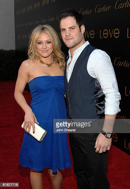 Singer Hilary Duff and New York Islander hockey player Mike Comrie arrive at the third annual Loveday celebration and Cartier Love Charity Bracelet...