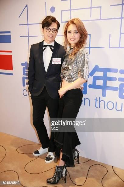 Singer Hins Cheung and singer Joey Yung attend the Concert of Ten Thousand Voices on June 26 2017 in Hong Kong China