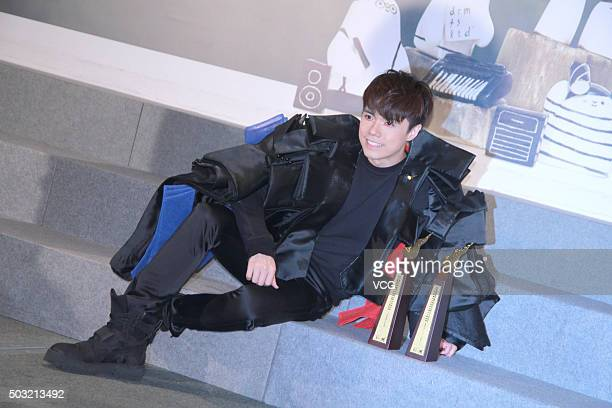 Singer Hins Cheung poses with the trophies after the Ultimate Song Chart Awards Presentation 2015 on January 2 2016 in Hong Kong China