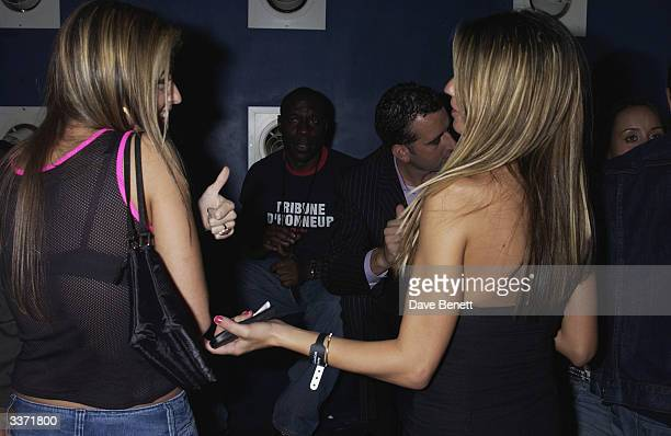 Singer Holly Valance talks to glamour model Jordan at Craig David's post MOBO Awards concert held at Scala on 7th February 2002 in London