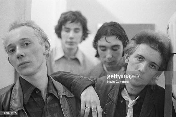 Singer Howard Devoto drummer John Maher bassist Steve Diggle and guitarist Pete Shelley of English punk band the Buzzcocks circa early 1977