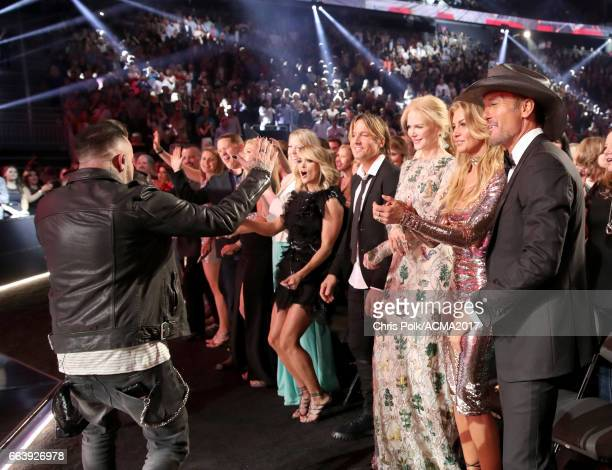 Singer Howie D of the Backstreet Boys performs while singer Carrie Underwood singer Keith Urban actor Nicole Kidman singer Faith Hill and singer Tim...