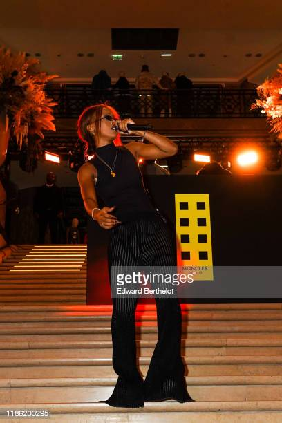 Singer IAMDDB is seen during Moncler House Of Genius : Paris Opening Event at Galeries Lafayette Champs-Elysees on November 07, 2019 in Paris, France.