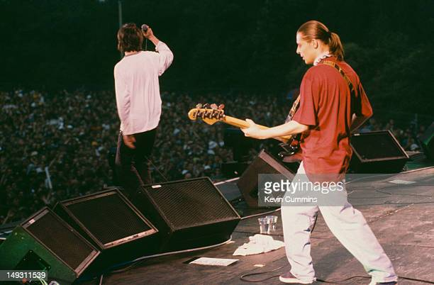 Singer Ian Brown and bassist Mani of English rock band The Stone Roses in concert at Spike Island Widnes Cheshire 27th May 1990